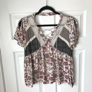 Gimmicks by BKE lace up floral baby doll top
